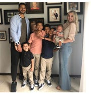 Logan Thomas, from left, with sons Logan Jr., 3, Cam, 11, Blake 10, Carter 9, Devin, 6 months, and wife Brandie.