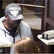This photo from bank surveillance video shows a man demanding money from a Chemical Bank branch in Grosse Pointe Woods on April 18, 2018.