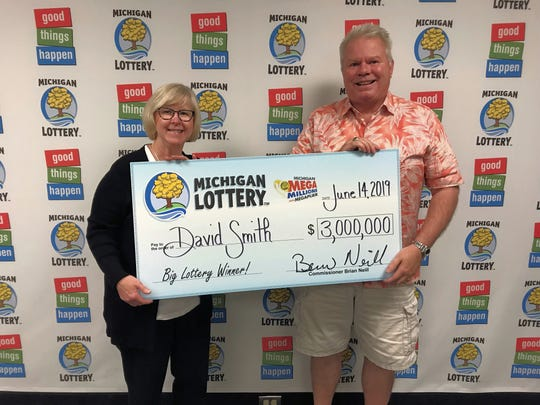 Kris Smith, left, and David Smith smile after claiming a $3 million Mega Millions prize.