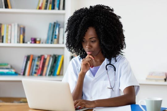Medical student learning at computer at hospital