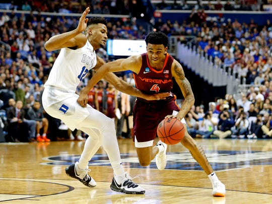 Virginia Tech guard Nickeil Alexander-Walker drives against Duke forward Javin DeLaurier during during the NCAA tournament in Washington, D.C., March 29, 2019.