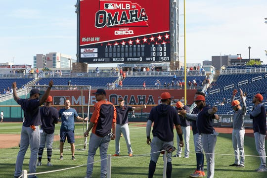 The Tigers warm up for a game against the Royals in Omaha, Neb., Thursday.