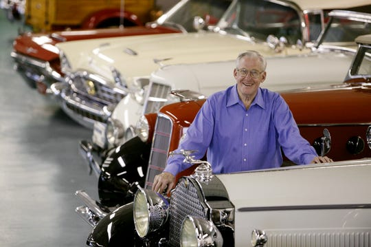 Richard Kughn, an original founder of the Meadowbrook car show, poses for a photo in his Carail Museum on Grand River in Detroit in 2003.