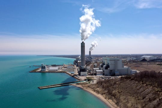 This April 25, 2019 photo shows the Oak Creek Power Plant and Elm Road Generating Station in Oak Creek, Wis., near Milwaukee. Environmentalists oppose a proposal by We Energies to change the way mercury is measured in water that it discharges to Lake Michigan from the Power Plant and Elm Road Generating Station.