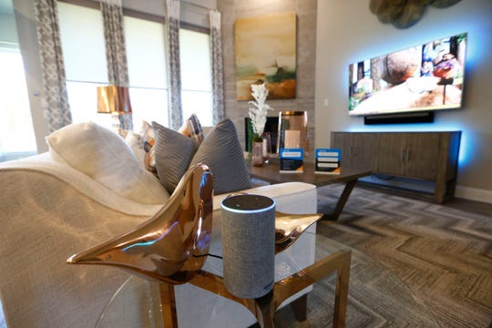 In this May 9, 2018, photo a second generation Echo that controls the blinds as well as televisions and lighting at an Amazon Experience Centers model home built by Lennar in Dallas, Texas.