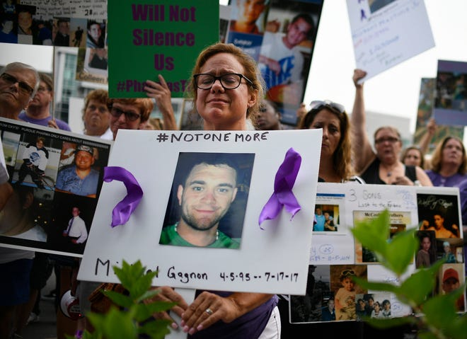 In this Friday, Aug. 17, 2018 file photo, Christine Gagnon of Southington, Conn. protests with other family and friends who have lost loved ones to OxyContin and opioid overdoses at Purdue Pharma LLP headquarters.