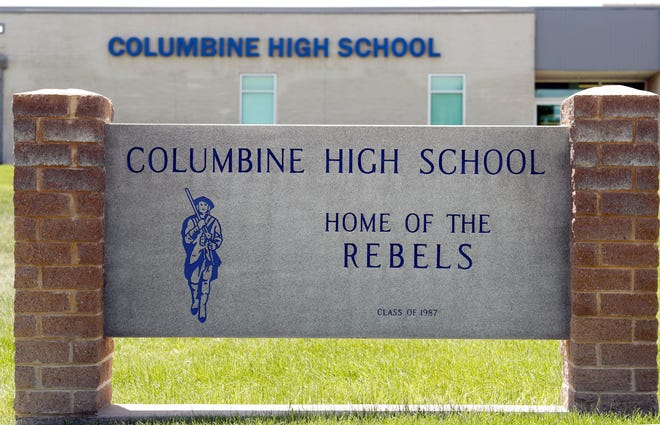 Signs outside Columbine High School are photographed, Thursday, June 13, 2019, in Littleton, Colo.