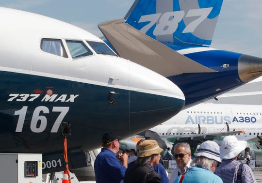 In this June 20, 2017, file photo Boeing planes displayed at Paris Air Show, in Le Bourget, east of Paris, France.