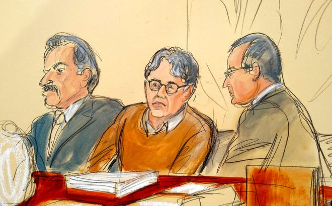 In this Tuesday, May 7, 2019 file courtroom drawing, defendant Keith Raniere, center, leader of the secretive group NXIVM, is seated between his attorneys Paul DerOhannesian, left, and Marc Agnifilo during the first day of his sex trafficking trial.  After weeks of relentlessly lurid testimony, federal prosecutors  have wrapped up their case against Raniere, a former self-improvement guru accused of sex trafficking.