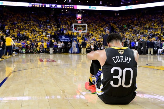 Golden State Warriors guard Stephen Curry reacts after teammate Klay Thompson was injured during the second half.