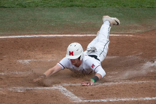 Orchard Lake St. Mary's Alex Mooney slides into home on a sacrifice fly in the first inning against Muskegon Oakridge.