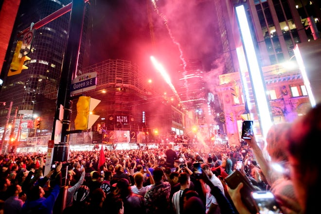 Thousands of fans celebrate in the streets of Toronto after the Raptors defeated the Golden State Warriorrs.