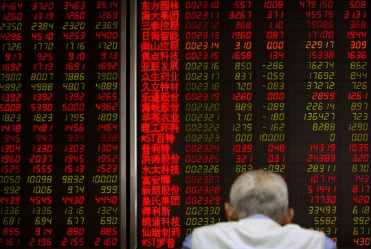 A Chinese investor monitors stock prices at a brokerage house in Beijing, Friday, May 31, 2019.