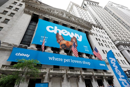 The facade of the New York Stock Exchange is decorated for the Chewy IPO, Friday, June 14, 2019.