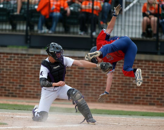 Grosse Point Liggett's Ian Narva is tagged out by Gladstone catcher Cooper Cavadeas despite Narva's best efforts in their semifinal game Friday.