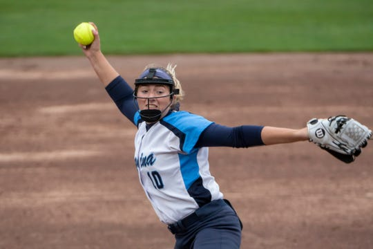 Marisa Muglia pitched a two-hit shutout and started a four-run seventh-inning with a lead-off single.
