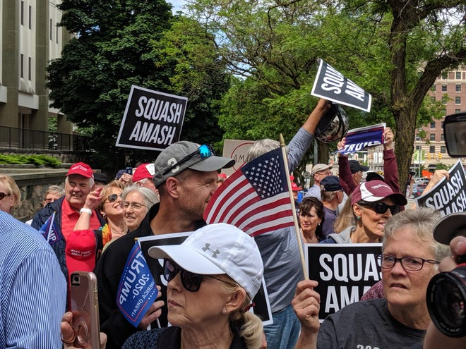 President Donald Trump supporters rally Friday (June 14, 2019) in opposition to U.S. Rep. Justin Amash, R-Cascade Township, near the congressman's office in downtown Grand Rapids.