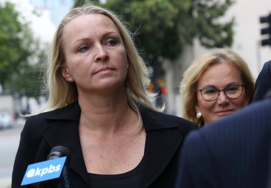 Margaret Hunter, left, wife of indicted Republican U.S. Rep. Duncan Hunter, arrives at federal courthouse in downtown San Diego on Thursday, June 13, 2019.