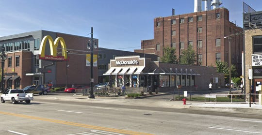 A woman in a wheelchair upset about the wait for her fast food fired a Taser at a McDonald's employee Thursday in Midtown, Wayne State University police said.