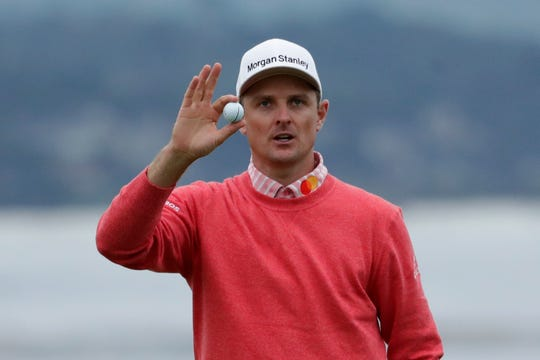 Justin Rose, of England, waves after his first round of the U.S. Open.