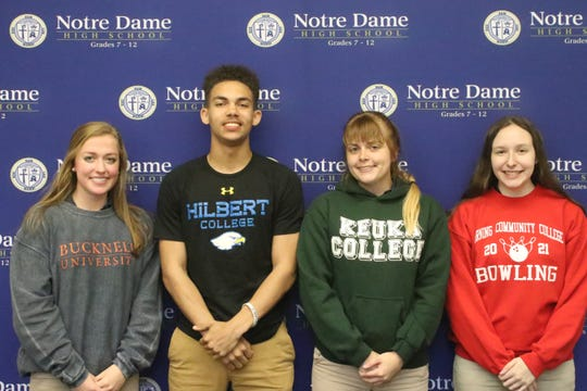Notre Dame High School seniors Catherine Craig, Kyreese Fisher, Jordyn Fargo and Rachelle Williams at a signing ceremony May 17, 2019 at Notre Dame High School.