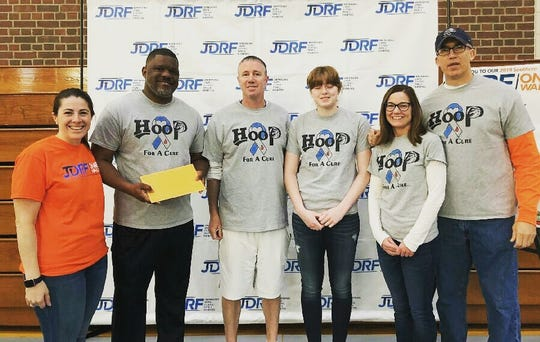 From left, Sarah Goldstein Post of the Rochester chapter of JDRF, Elmira JV girls basketball coach A'Don Allen III, Horseheads girls varsity coach Andy Scott, Horseheads player Jillian Casey, Molly Romanski and Horseheads modified coach Mark Romanski at a check presentation May 11, 2019 to present nearly $900 to the Juvenile Diabetes Research Foundation.