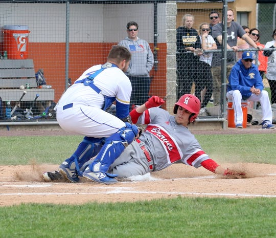 Maine-Endwell catcher Matt Raleigh tags out Canandaigua's Caden Lefave at home during the Spartans' 5-4 win in a Class A baseball state semifinal June 14, 2019 at Union-Endicott High School.