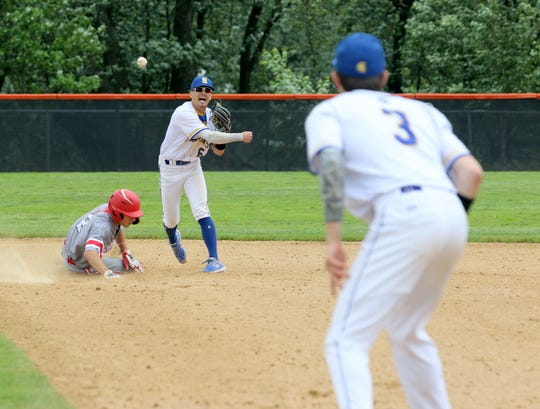 Maine-Endwell second baseman Michael Mancini throws to first baseman Jack McFadden to complete a double play as Canandaigua's Dylan Mackenzie slides into second during a Class A state semifinal June 14, 2019 at Union-Endicott High School.