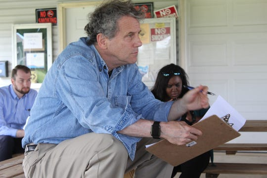 U.S. Senator Sherrod Brown takes notes during a discussion with elected officials, scientists and business people that work along Lake Erie in Ottawa County. Brown said the visit to the county gave him a better understanding of issues affecting the health of Lake Erie.