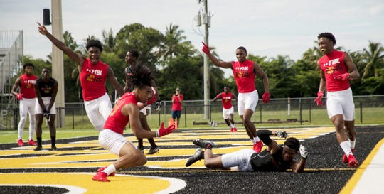 John Coleus of Lee County All-Stars reacts as a pass is bobbled and intercepted by Prime TRUTH's Kameron Silmon during a scrimmage game at Bishop Verot High School. Deion Sanders is expanding his 7v7 league to Southwest Florida.