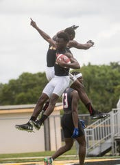 Koby Moore of the Lee County All-Stars celebrates a touchdown against the Mississippi GRIND during a scrimmage game at Bishop Verot High School.  Sanders is expanding his 7v7 league to Southwest Florida.