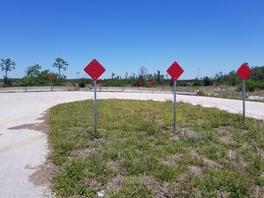 U-turn marks the end of Three Oaks Parkway at a canal in south Fort Myers, but work will begin soon on extending the north/south roadway to Daniels Parkway.