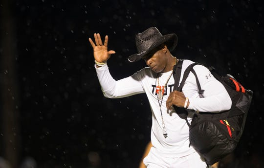 Deion Sanders acknowledges fans after leading his PRIME TRUTH 7-on-7 football game at Bishop Verot High School in Fort Myers. The all-star game features players from Texas and Lee County.