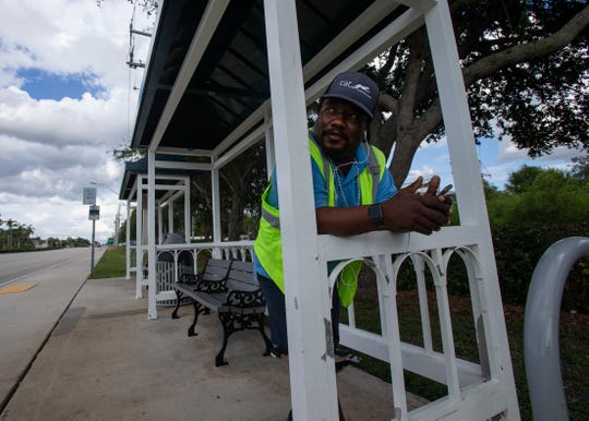 Collier Area Transit bus driver Joseph Confident takes a break in a covered bus shelter after completing his final stop, Friday, June 14, 2019, on Immokalee Road in North Naples.