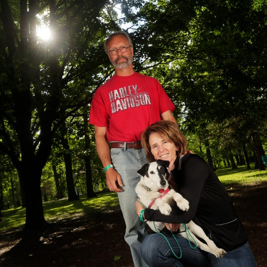 Karen Cashman and Dave Stubenvoll of Rockland with their dog Halle at the Pooches & Pints popup dog park at Green Isle Park on Thursday, June 13, 2019 in Allouez, Wis.