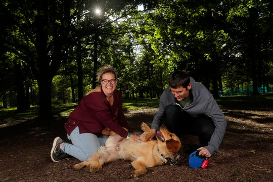 Andrea and Brian Houston of De Pere with their dog, Rocket, at the Pooches & Pints popup dog park at Green Isle Park on Thursday, June 13, 2019 in Allouez, Wis.