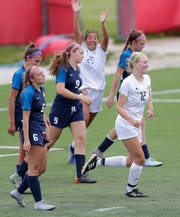 Divine Savior Holy Angels' Sonja Kuranz (12) celebrates scoring the game-winning goal against Bay Port during a WIAA Division 1 girls state soccer semifinal Friday at Uihlein Soccer Park in Milwaukee.