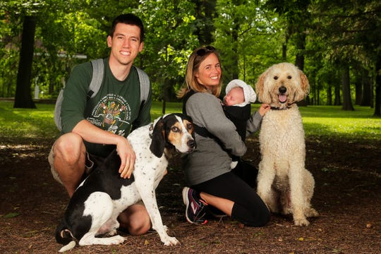 Jen and Alex Debbout with baby Ruby and dogs Finn, left, and Murphy at the Pooches & Pints popup dog park at Green Isle Park on Thursday, June 13, 2019 in Allouez, Wis.