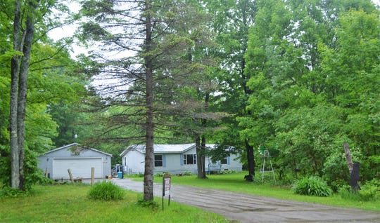 The home of murder suspect Raymand Vannieuwenhoven, located on the southeast corner of Lakewood in northern Oconto County is seen Friday. Vannieuwenhoven is charged with killing David Schuldes and Ellen Matheys of Green Bay on July 9, 1976 at McClintock Park in the town of Silver Cliff, about 20 miles to the northeast in Marinette County.