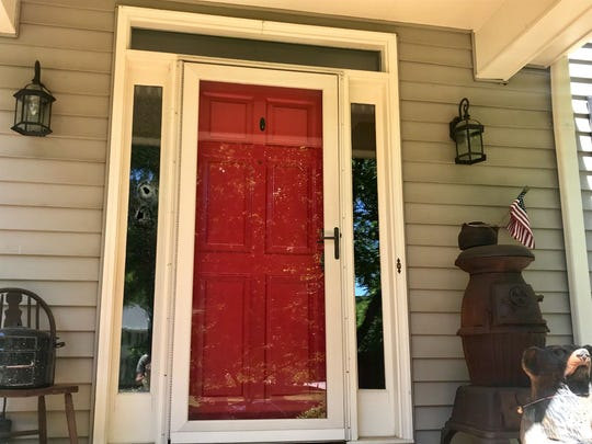Bullet holes can be seen in a window by the front door of a home on Eastcrest Drive in Simpsonville. Investigators say a homeowner pulled a gun on a deputy and the deputy fired at the homeowner.