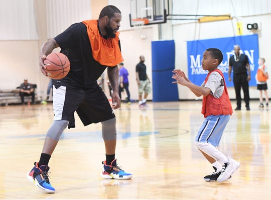 Braylon Duck, 9, guards Trevor Booker during a game at Booker's basketball camp at Mauldin Sports Center Friday, June 14, 2019.