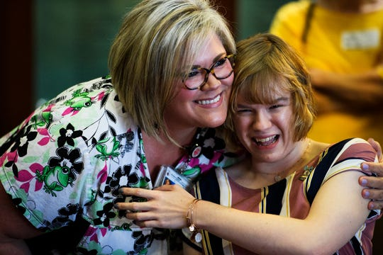 Logan Hopper, right, hugs nurse Morgan Smith during a bell ringing ceremony at Shriners Hospitals for Children Friday, June 14, 2019.