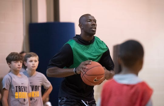 Terrell Owens plays basketball with kids attending Trevor's basketball camp at Mauldin Sports Center Friday, June 14, 2019.