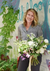 Kelly Singer, owner of Earthblooms.