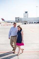 Kate Jones and Billy Malewich credit Greenville-Spartanburg International Airport with helping their long-distance relationship bloom, so they had their engagement photos taken there.
