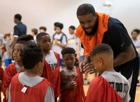 Trevor Booker talks with his teammates during basketball camp at Mauldin Sports Center Friday, June 14, 2019.