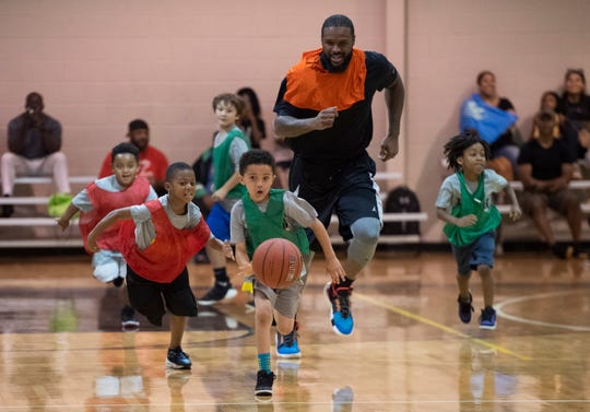 Trevor Booker plays basketball with kids attending the basketball camp at Mauldin Sports Center Friday, June 14, 2019.