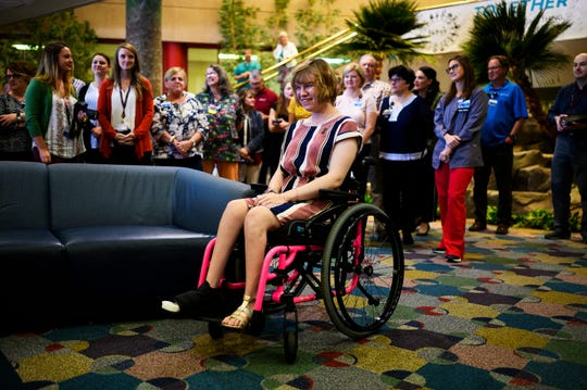 Logan Hopper, 21, during a bell ringing ceremony at Shriners Hospitals for Children Friday, June 14, 2019.