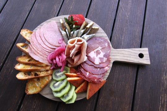 Assorted meat and cheese snack board from Habitap.