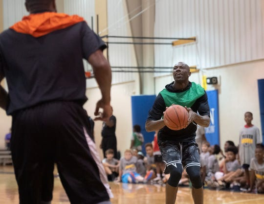 Terrell Owens plays basketball with Trevor Booker and kids attending Trevor Booker's basketball camp at Mauldin Sports Center Friday, June 14, 2019.